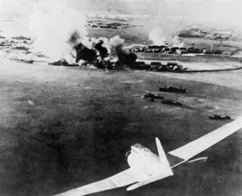 buildings and ships smoking after Japanese Attacked Pearl Harbor