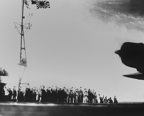 Crews Wave From Japanese Aircraft Carrier