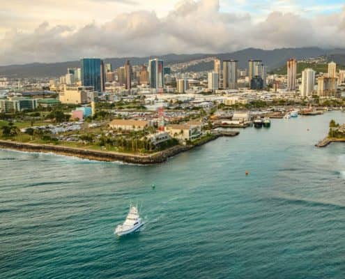 A Boat Leaves Honolulu Harbor