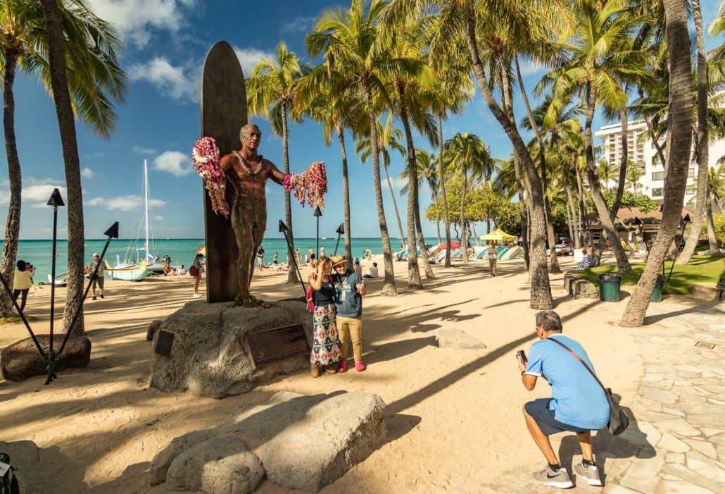 Duke Surfing Statue Kuhio Beach in Waikiki with people