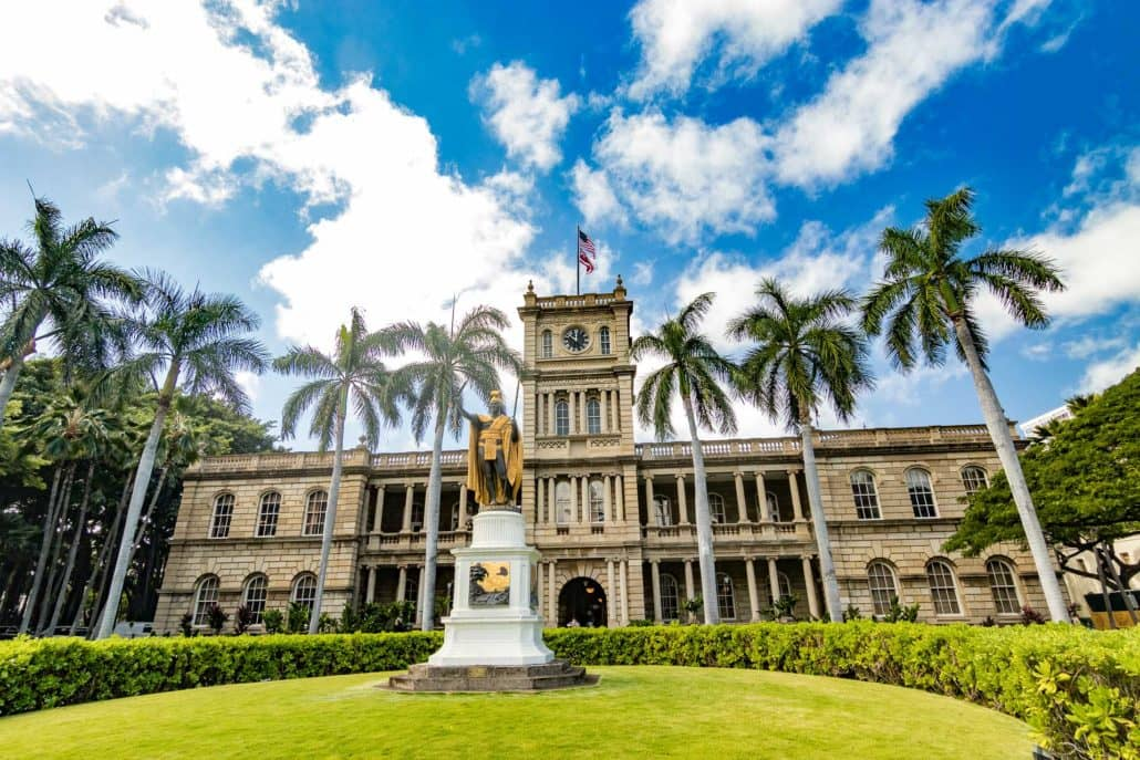 King Kamehameha Statue foreground in front of building