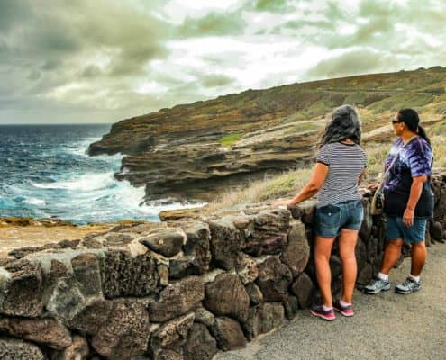 Visitors at Pali overlooking coast
