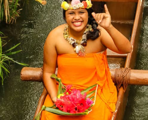 Polynesian Cultural Center Performer wearing Orange