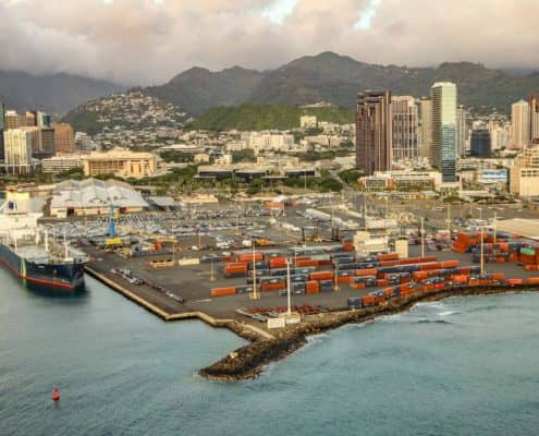 Ship and Shipping Containers Sitting at Honolulu Harbor aerial