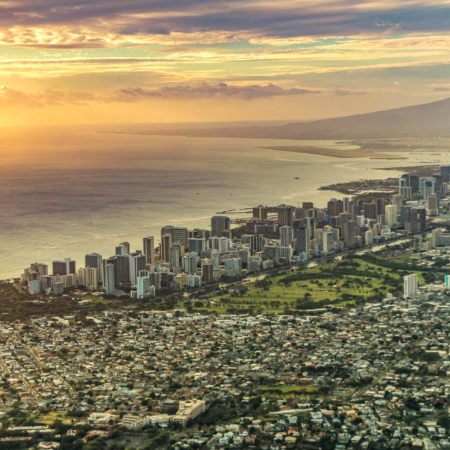 Sunset over Waikiki and Honolulu City aerial view