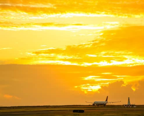 Sunset of Plane Landing at Honolulu Airport
