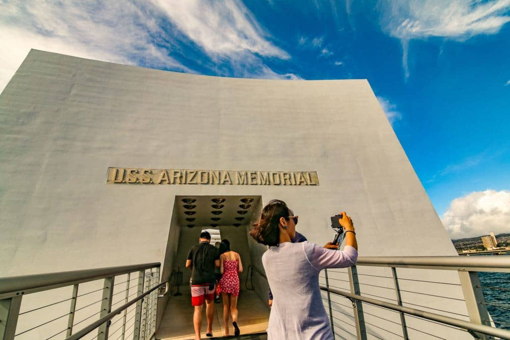 Woman Taking Photo at Arizona Memorial Entrance