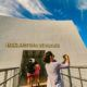 Woman Taking Photo at Arizona Memorial Entrance