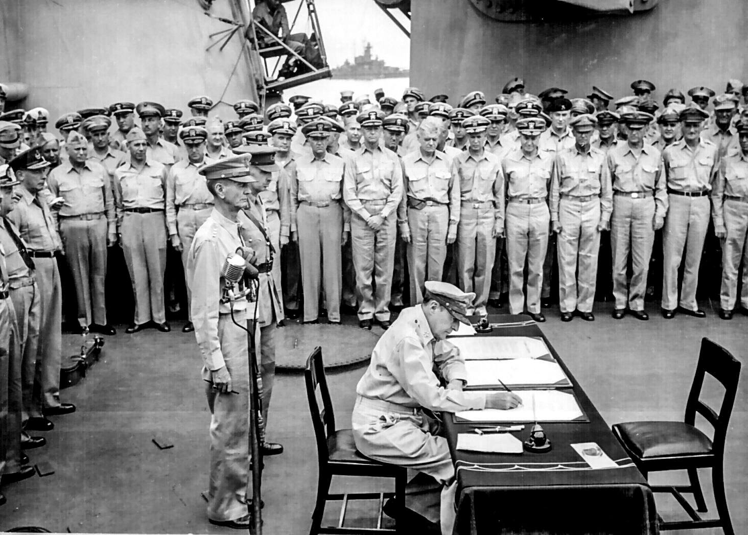 Douglas MacArthur signs formal surrender aboard USS Missouri Sept  US Navy photo wikimedia