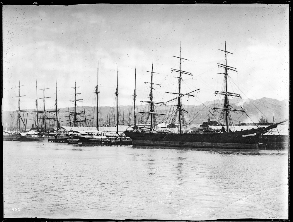 Sailing vessels at wharf in Honolulu harbor, ca. USC