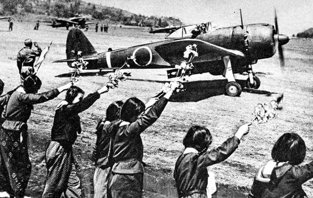 Chiran high school girls wave kamikaze pilot