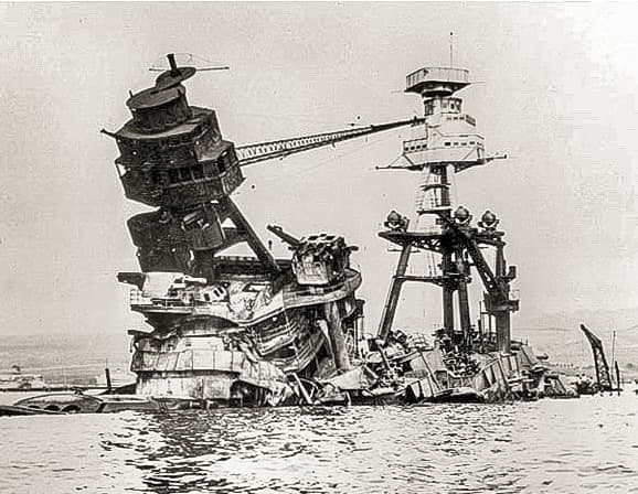 USS Arizona superstructure Dec after sinking at Pearl Harbor by US Navy wikimedia