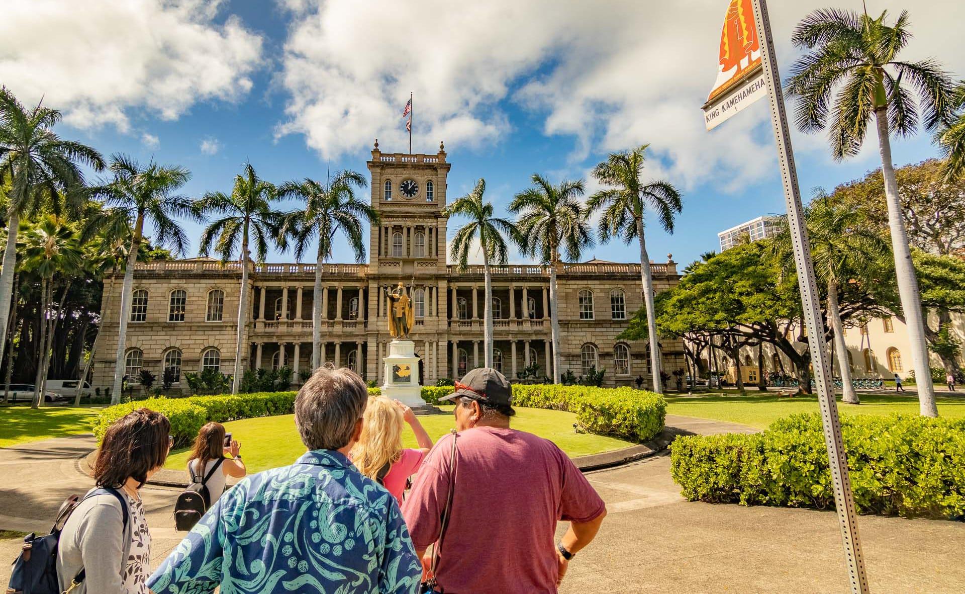 Aliiolani Hale and Kamehameha Statue Visitors and Sign Honolulu