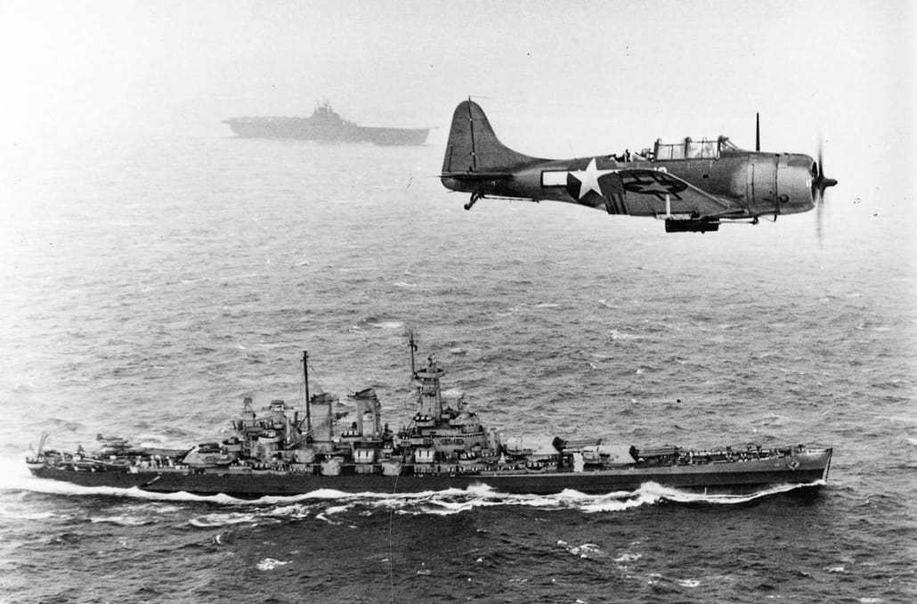 SBD Dauntless over USS Washington andUSSLexington