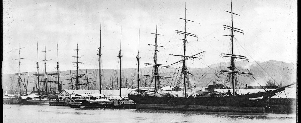 Sailing_vessels_at_wharf_in_Honolulu_harbor,_ca.1892-1907_USC