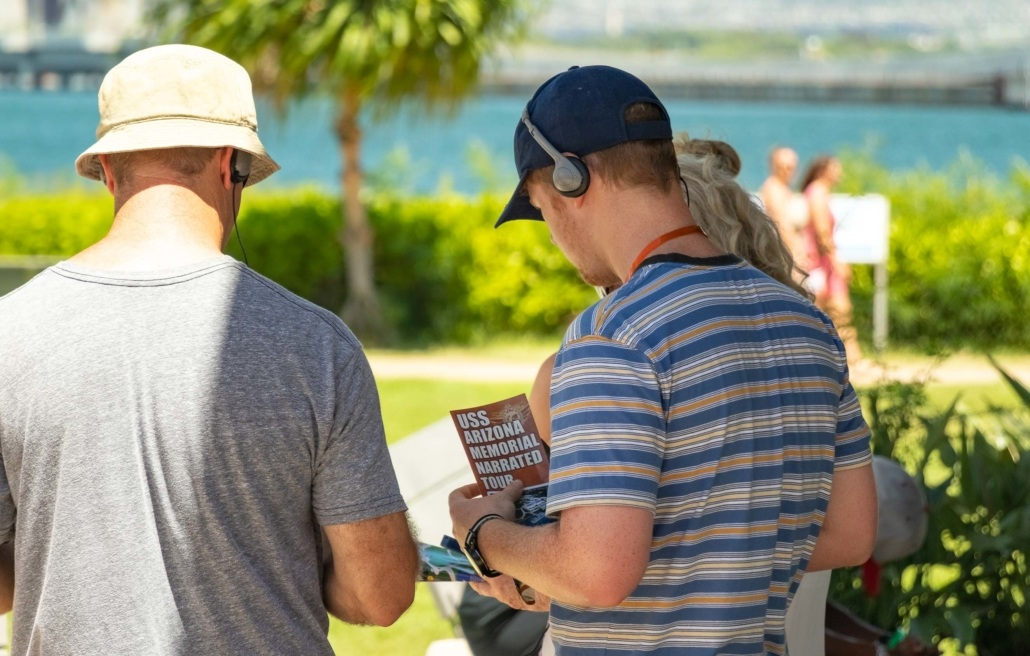 Pearl Harbor Visitors Using Audio Tour Headset Oahu