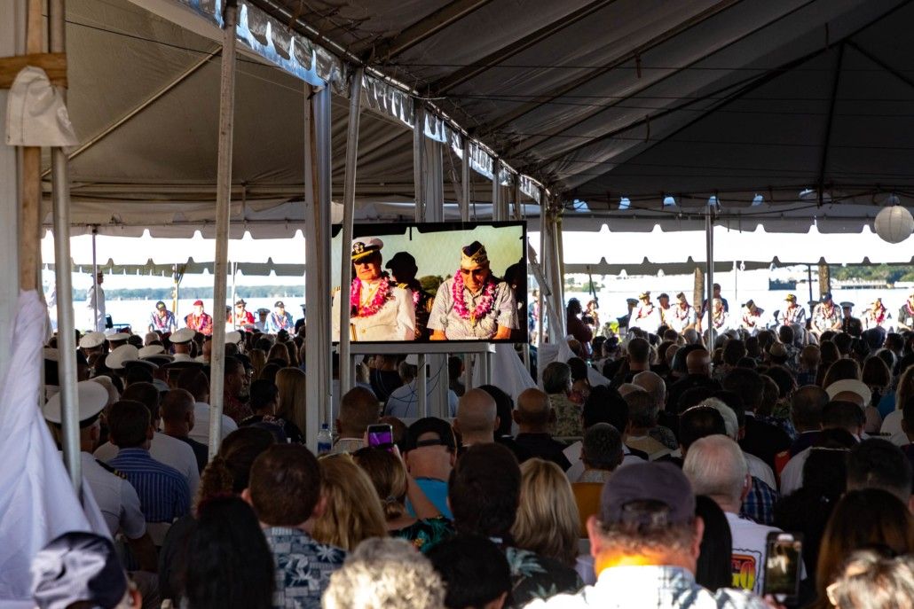 Pearl Harbor Day Tent Crowd and Survivors on TV