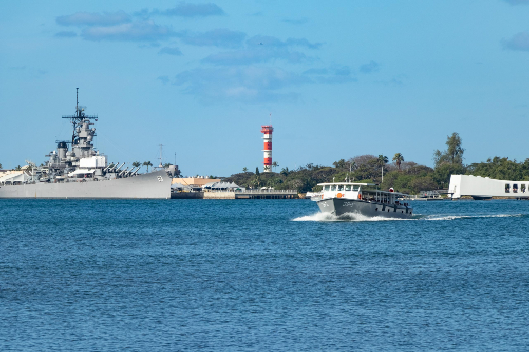 A U.S. Navy launch brings visitors back from the Arizona Memorial