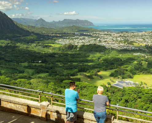 Visitors stand at the iconic Nuuanu Pali Lookout