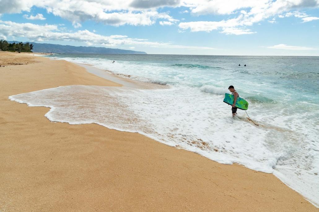 Banzai Pipeline Beach and Boogie Boarder North Shore Oahu